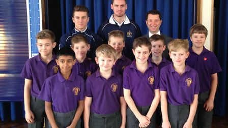 Cunningham Hill Junior School pupils are pictured with, from back left, Matt Taylor, James Kaloczi a