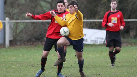 Tom Collin tries to control the ball
