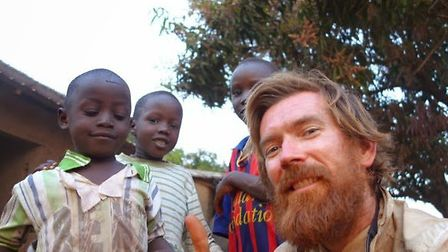 Chris Young with children in Sierra Leone