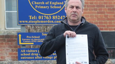 Steeple Morden Primary School headteacher Richard Lloyd with a letter sent to parents outlining his