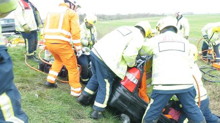 The emergency services working together to rescue a woman after the car crashed into a ditch. Pictur