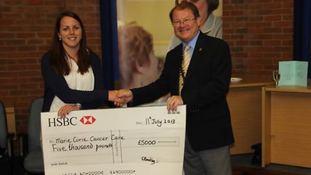 John Thornton presenting a cheque at last year's Cycle Ride presentation evening