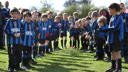 Harpenden Colts form a guard of honour for the teams before kick off