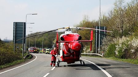 The air ambulance lands at the scene - picture by @AmboOfficer