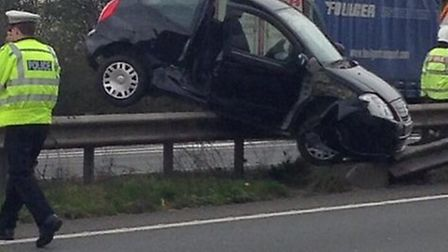 A woman in her 20s suffered minor injuries in a crash which left her car stradding the A14 central r