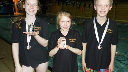 Yasmine Clitheroe, Madeline Todd and James Quinn are all Cambs County champions after winning gold m