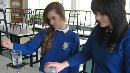 Ellie Ferrie and Georgie Bull in the lab at Melbourn Village college