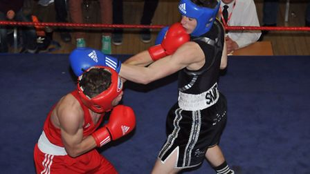 Bradley Smith takes a punch on the chin from Levi Chandler at the St Ives clubs show at the Corn Exc