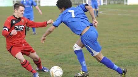 Mike Hyem on the ball for Huntingdon against Cogenhoe in their recent 1-1 draw at home. Picture: Hel