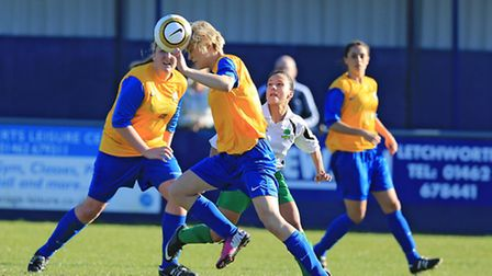 Royston ladies' Amy Cooper heads the ball