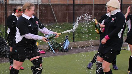 Ladies' 2nds' captain Martine Powley sprays top-scorer Wendy Holt with champagne.