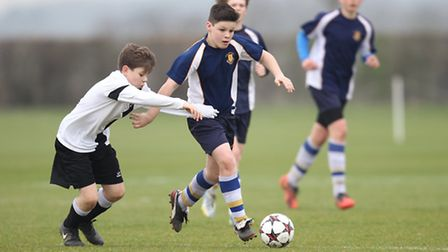 Match action from district cup football final at Woollams playing fields in St Albans