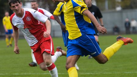 James Comley in action against Poole Town. Picture: Bob Walkley