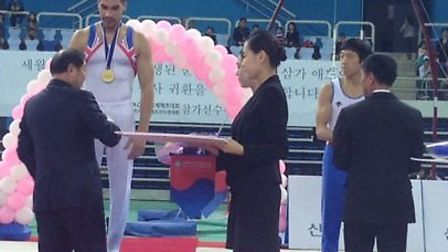 Louis Smith recieves his gold at the World Cup meeting in South Korea.