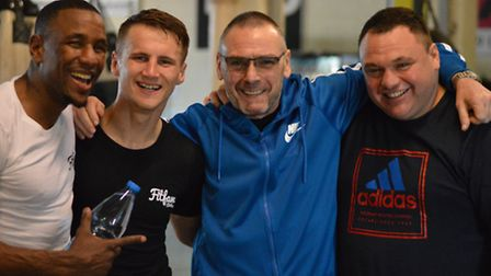 Tommy Martin, with sparring parner Darren Hamilton, left, manager Johnny Eames, and trainer Barry Sm