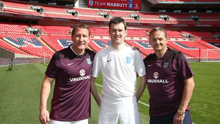Tom Ward with Ray Parlour, left, and Gary Mabbutt, right. Picture: Jakob Ebrey