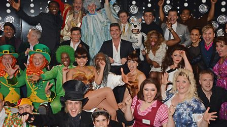 LONDON, ENGLAND - MARCH 26: Producer Simon Cowell (C) poses with the cast backstage following the p