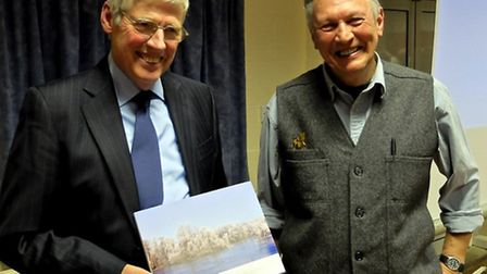 The reserve's senior ranger Jim Stevenson (right) presents former chairman of Friends of Paxton Pits