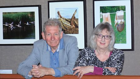 Photographers Clive Porter and Sue Sanders with some of the work in the exhibition (Pic: CP Promotio