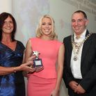 Zoe Jackson receiving her Chamber award from Dawn Brown of Oaklands College and Chamber President Pe