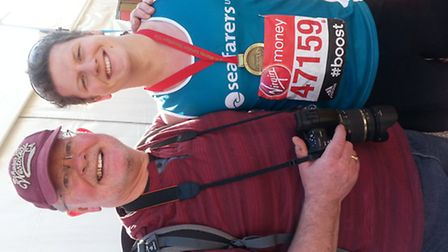 Angus with his dad Rod after the race