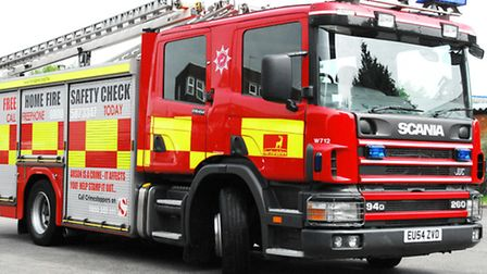 Firefighters were called to a caravan and house fire in Whaddon last night (Sunday)