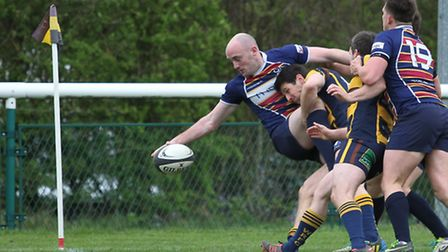 Gregg reaches for the line as he is tackled
