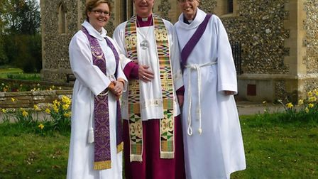 The Bishop of Norwich, the Rt Revd Graham James, flanked by Rev Em Coley, Vicar of Sandridge, and Re