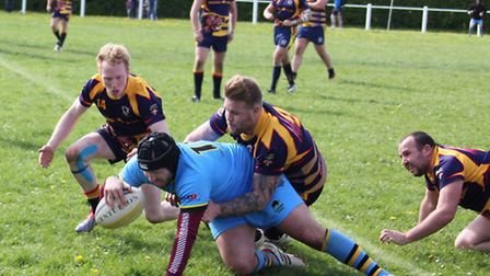 Mike Hollister score the 'golden point' to win the game for the Cents.