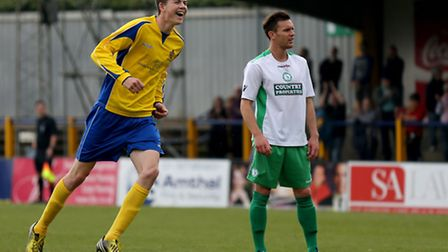 The two emotions of football: George Sykes enjoying is 28th minute goal whilst the opposition looks