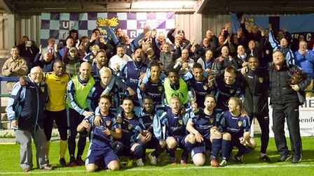 St Neots Town and the club's fans celebrate winning the Huntst FA Senior Cup. Picture: Helen Drrake