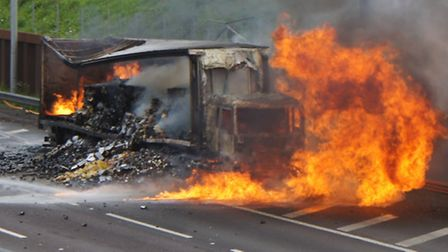 Firefighters tackle the lorry blaze - Photo by Derrick Davies
