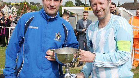 St Albans City joint manager Graham Golds presents the Intermediate Cup to Queens Head Sandridge ski