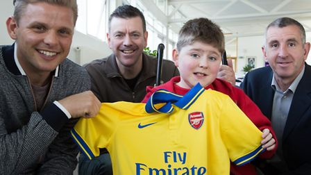 Twelve-year-old Tom Mayer with (from left) Jeff Brazier, dad, Dean, and former Arsenal defender and