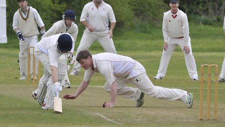 A close shave during Godmanchester Town's win over Warboys. Picture: Helen Drake