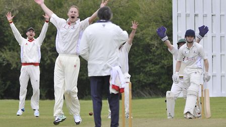 Godmanchester bowler Paul Jefferson claims a wicket. Picture: Helen Drake