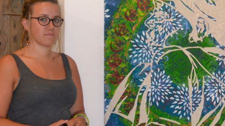 Beth Spalding and an example of her artwork, inspired by her trip to India.