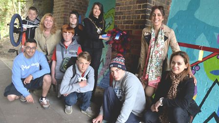 Cunningham Hub members with the Mayor by the mural