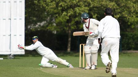 Wicket Keeper Syed Shah takes a edge from a Masroor Raja delivery