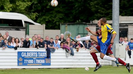 James Comley tries to lift the ball over the Chesham keeper. Picture: Leigh Page