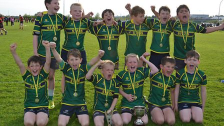Huntingdon & District under-9s Gold team celebrate their East Midlands Mobbs Championship win at Fr