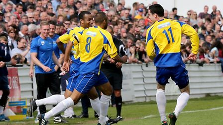 James Comley and Howard Hall go to celebrate with Steve Wales after scoring the Saints second of the
