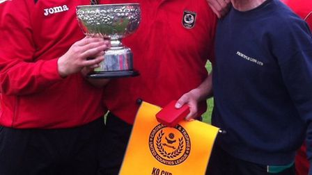 Seb Hayes is flanked by coaches Mark Arber (left) and Paul Swannell after Huntingdon Town's UCL Cup