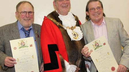 Mayor David Underwood (centre) presents Honorary Freeman of Godmanchester titles to (left) Pat Doher