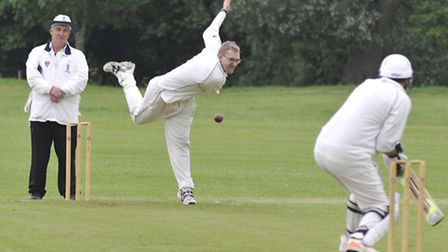 Sawtry bowler David Atkinson in action against Alconbury. Picture: Helen Drake