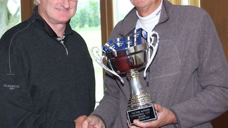 Peter Hill, right, presents the Soanes Trophy to David Jack.