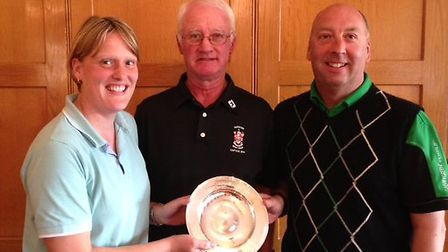Eddie Hughes Plate winners Sarah Buckerfiled and Stuart Hart receiving their trophy from RGC Captain