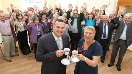 John-Paul Halliwell, Builder with Wendy Evans, Vice-Chair Whaddon village hall trust, toast the new