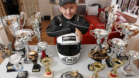 Young karter Josh Steed with some of his trophies