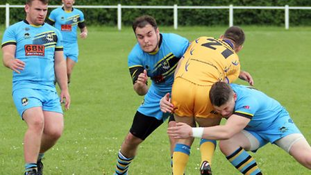 Scott Clewlow and Ryan Shorter make the tackle.